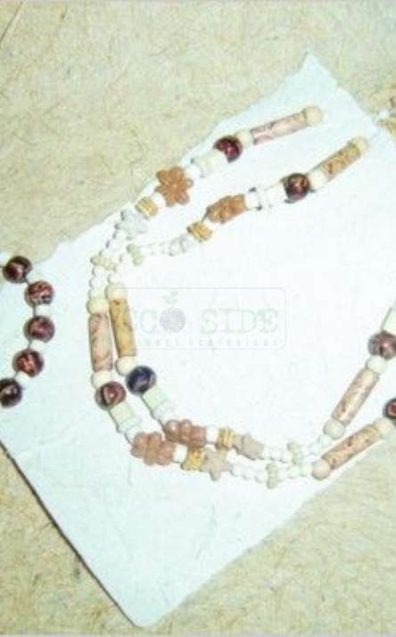 conjunto de pulseira e colar com semente